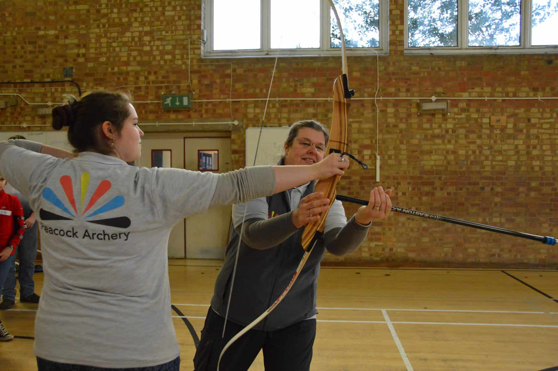 Mary Watson of Peacock Archers sets up a beginners course