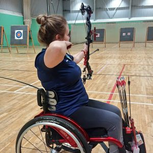 Disabled archer shooting indoors