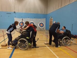 wheelchair archers and coaches